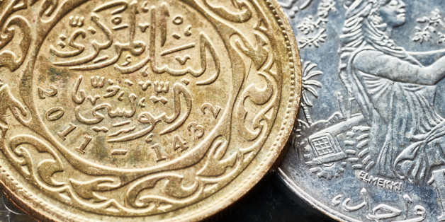 Close up picture of Tunisian dinars, shallow depth of field.
