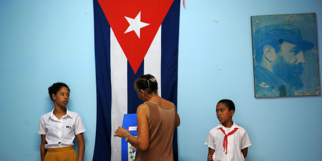 A voter casts her ballot at a polling station in Havana Vieja neighbourhood in Havana, on November 26, 2017, during municipal elections.Cubans vote this Sunday in the first round of municipal elections that will mark a turning point in Cuban history. The polls will kick off a series of elections ending in February 2018 with the first top government generational change in 60 years -- the election of Raul Castro's replacement, who will, for the first time, be a post-revolutionary figure. / AFP PHO