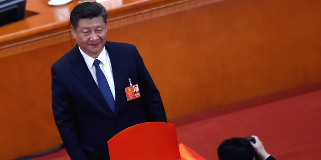 Chinese President Xi Jinping poses for a picture after voting during the third plenary session of the first session of the 13th National People's Congress (NPC) at the Great Hall of the People in Beijing on March 11, 2018. China's rubber-stamp parliament is set on March 11, to hand President Xi Jinping free rein to rule the rising Asian superpower indefinitely, with potential abstentions offering the only suspense in the historic vote. / AFP PHOTO / WANG ZHAO        (Photo credit should read WANG ZHAO/AFP/Getty Images)