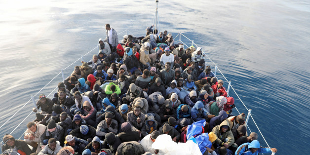 Migrants are seen in a boat as they are rescued by Libyan coast guards in the Mediterranean Sea off the coast of Libya, January 15, 2018. Picture taken January 15, 2018. REUTERS/Hani Amara