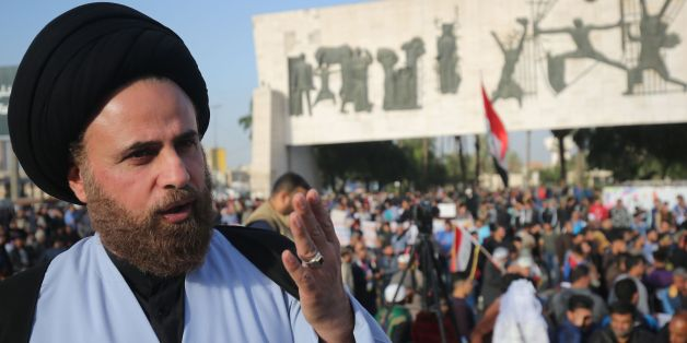 Ibrahim al-Jabiri, one of the leaders of Iraq's Shiite Sadr Movement, gives an interview during a demonstration by the movement in the capital Baghdad's Tahrir square against corruption in the Iraqi government on March 2, 2018.Followers of a black-turbaned Shiite cleric are seeing red ahead of Iraq's May elections, allying with the once-powerful communist party for the first time in the country's history. / AFP PHOTO / AHMAD AL-RUBAYE        (Photo credit should read AHMAD AL-RUBAYE/AFP/Getty Im