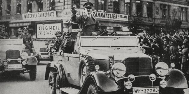 Austrians welcoming Adolf Hitler's arrival into Vienna, Anschluss, Austria, from L'Illustrazione Italiana, Year LXV, No 12, March 20, 1938.