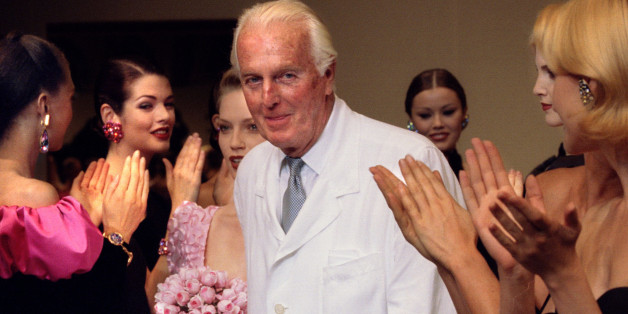 French fashion designer Hubert de Givenchy is applauded by the models after he presented his last High Fashion collection Autumn/Winter 1995 in Paris July 11. Givenchy will be retiring at the end of the year