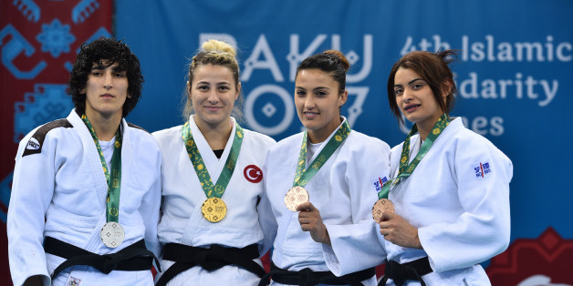 (From L) Azerbaijan's Khanim Huseynova (silver), Turkey's Busra Katipoglu (gold), Algeria's Amina Belkadi (bronze) and Tunisia's Mariem Bjaoui (bronze) attend the Baku 2017 4th Islamic Solidarity Games Women's Judo -63 kilos podium ceremony at the Heydar Aliyev Arena in Baku, on May 13, 2017.AFP PHOTO / GLYN KIRK/Baku 2017/AFP-Services        (Photo credit should read GLYN KIRK/AFP/Getty Images)