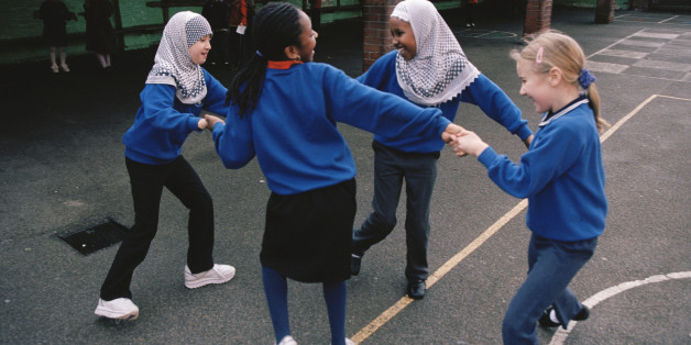 (Original Caption) Girls enjoying themselves on the playground of Melcombe Primary School, a formerly failing inner-city school, which has been transformed by the work of a new head and dedicated senior management. Many of the students come from backgrounds which could present educational challenges, such as refugee status, non native English speaking homes and children in temporary accommodation. Staff successfully address these issues and the school has become a government 'beacon' school.
