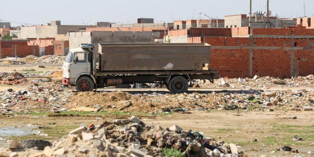 Kairouan,Tunisia - September 16, 2012 : Truck on a construction site full of garbage in Kairouan, Tunisia.