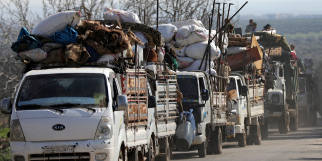 People ride on trucks with their belongings in north-east Afrin, Syria March 13, 2018. REUTERS/Khalil Ashawi