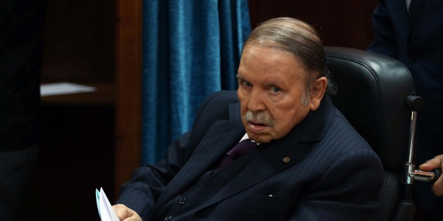 Algerian President Abdelaziz Bouteflika heads to vote at a polling station in Algiers on November 23, 2017 as Algeria goes to the polls for local elections. (Photo by Billal Bensalem/NurPhoto via Getty Images)