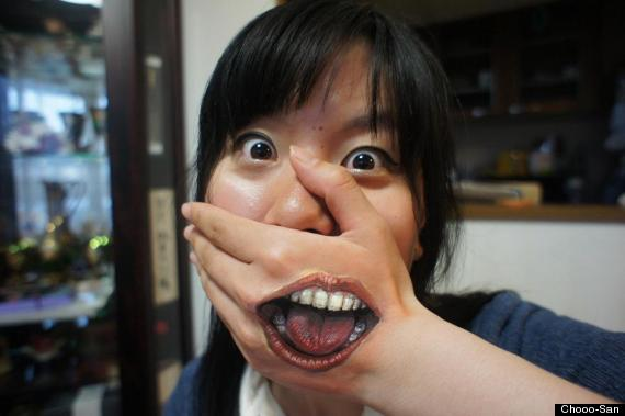 mouth on hand
