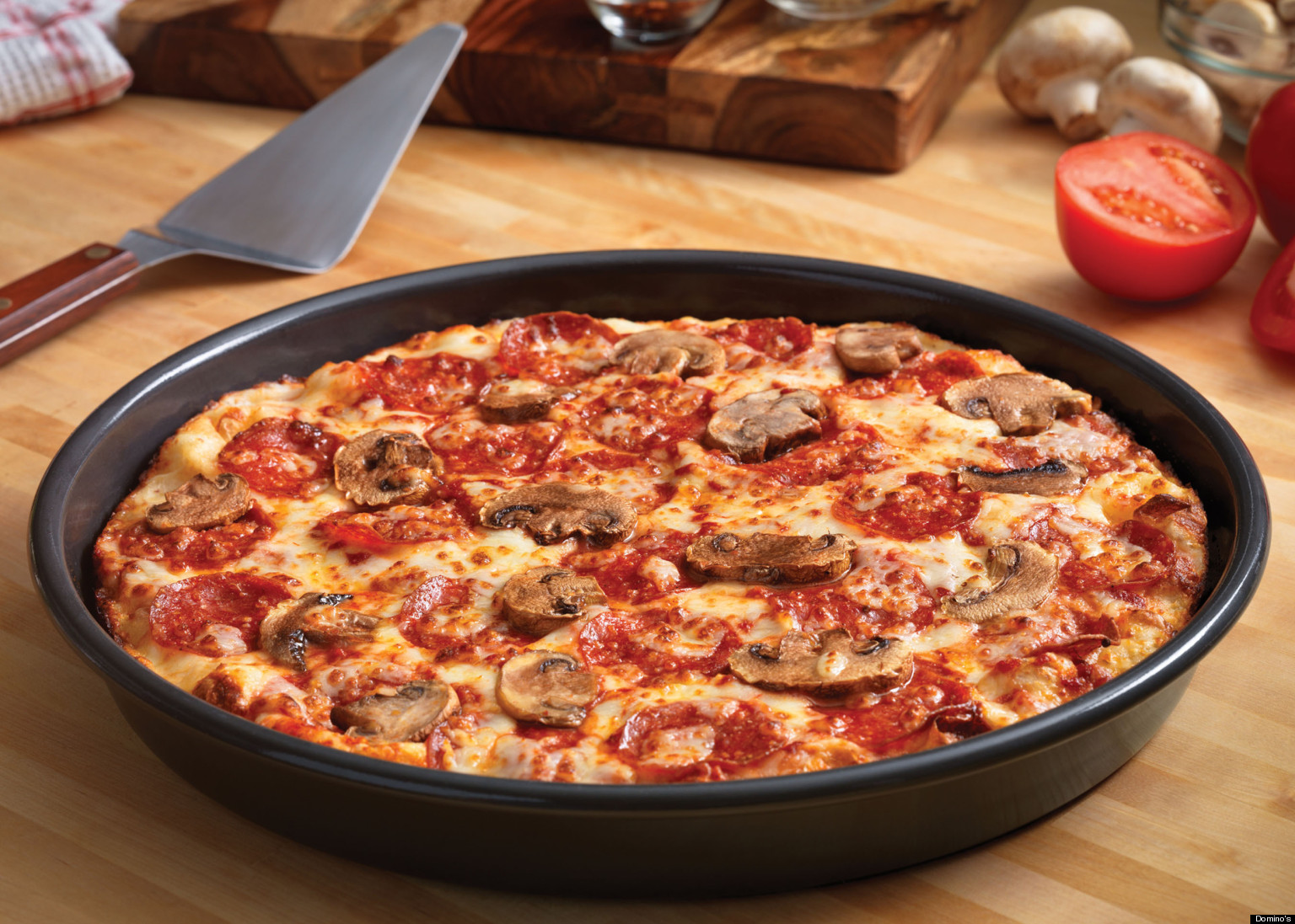 handmade pan pizza from dominos domino s introduces handmade pan pizza marches in on 7625