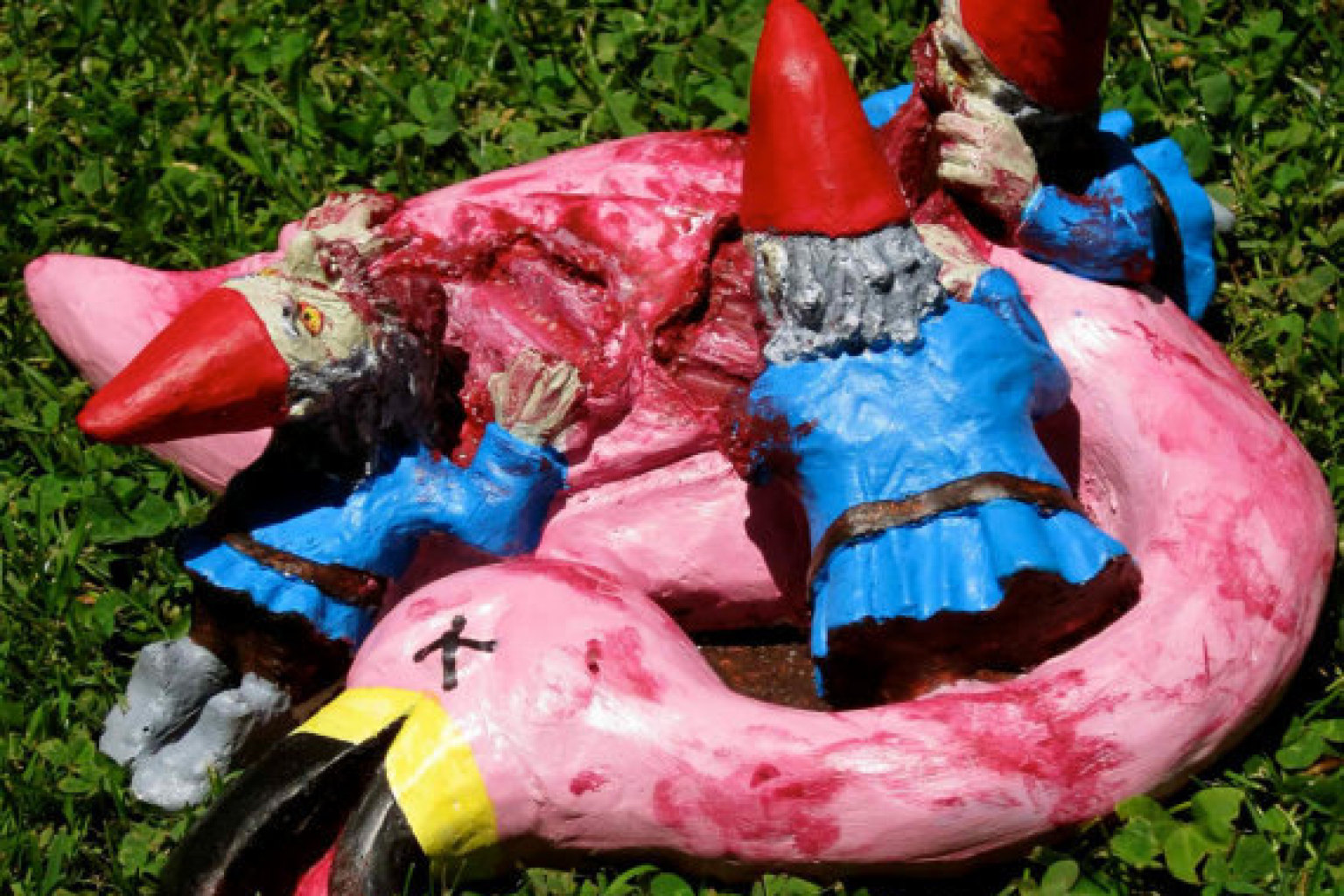Zombie Lawn Gnomes Gnaw On Flamingo And 13 Other Crazy Lawn