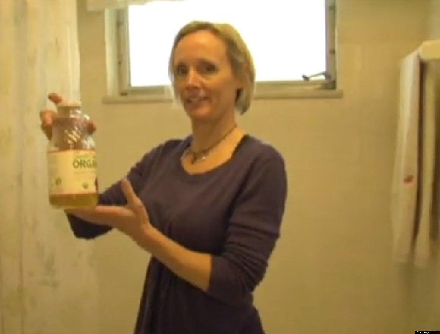 Woman peeing in bottle