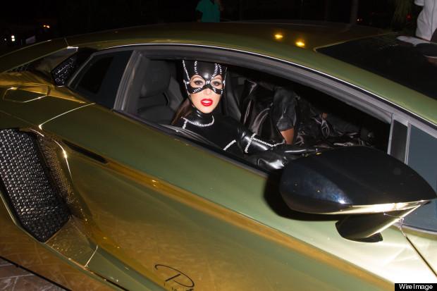 Kim Kardashian Rolls Up To Halloween Party In Gold Lamborghini