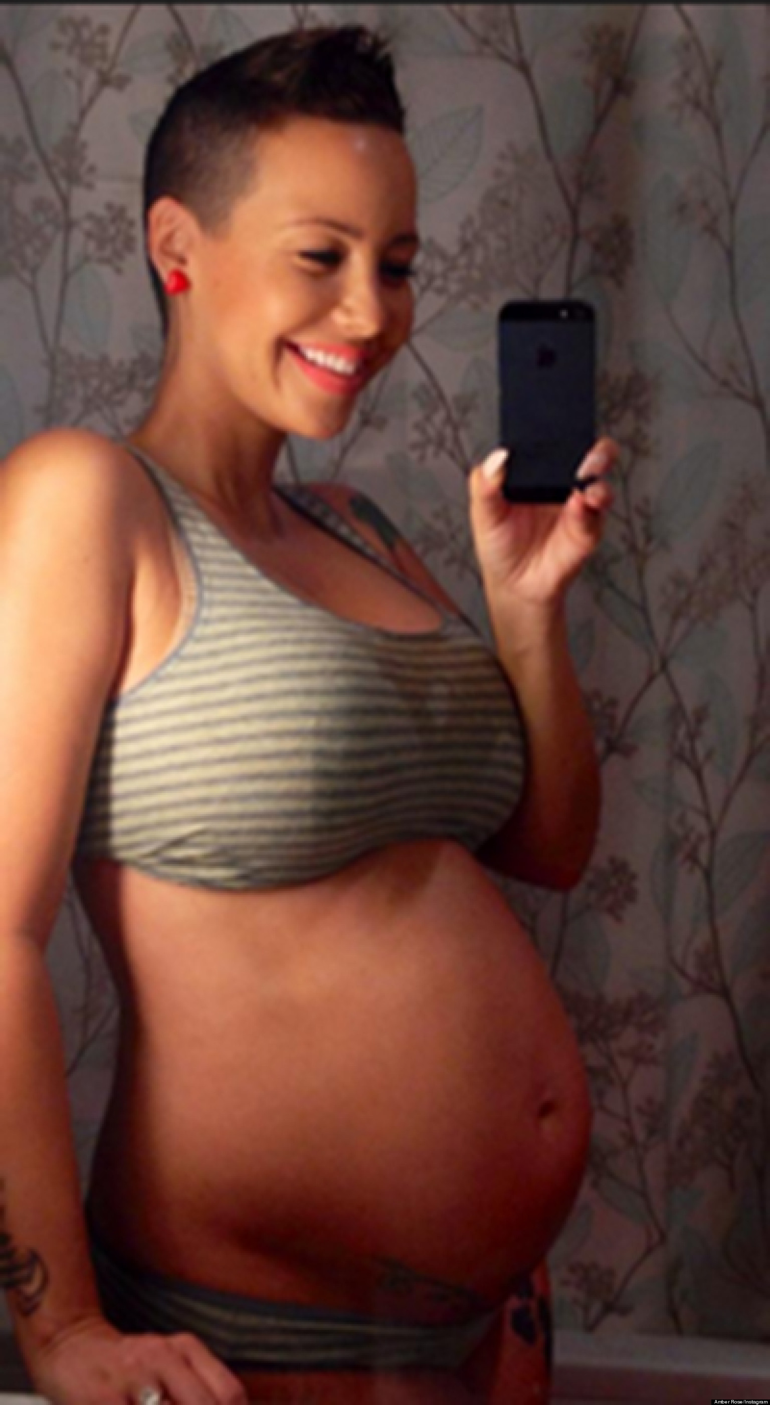 amber rose's nude baby bump: pregnant model posts picture of her